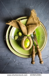 stock-photo-festive-easter-table-setting-with-colored-eggs-and-easter-bunny-concept-with-copyspace-1039212061